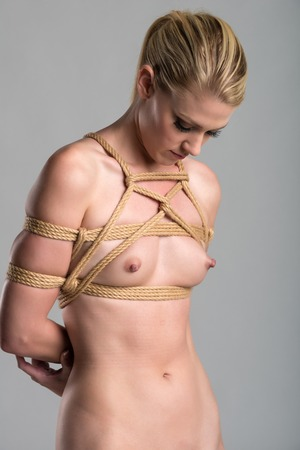 nude blonde woman: Beautiful slender nude blonde woman bound at the wrists