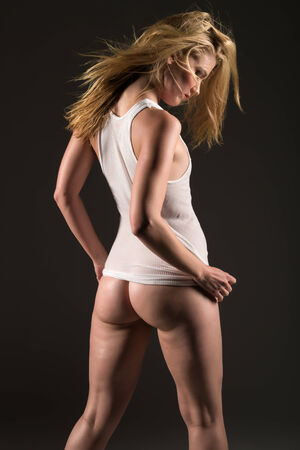 Beautiful slender blonde woman in a white undershirt photo