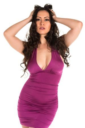 Beautiful multiracial woman in a tight purple dress Stock Photo