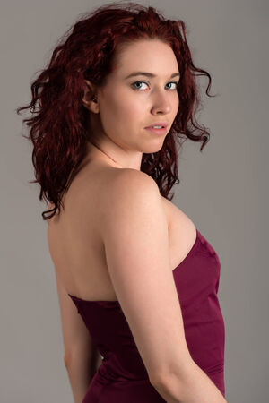 strapless: Pale redhead in a strapless purple dress