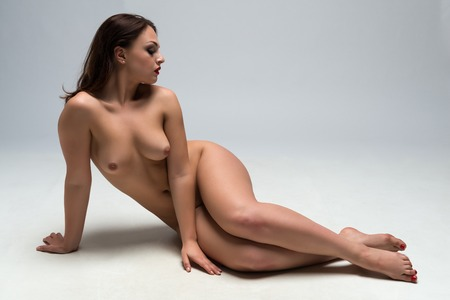 Nude Ukrainian woman lying on the floor Stock Photo