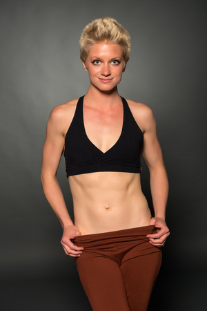 sweats: Pretty athletic blonde woman in workout clothes Stock Photo