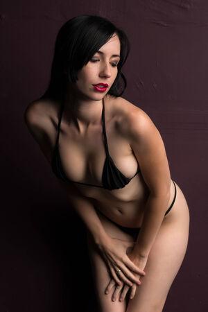 skimpy: Pretty young brunette in a skimpy black bikini