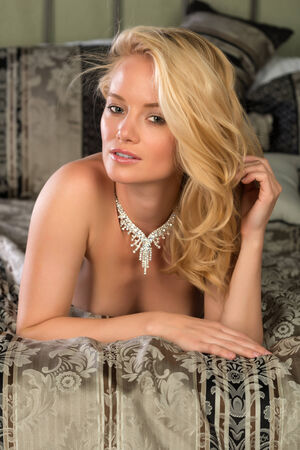 Beautiful young Hungarian blonde topless in bed photo