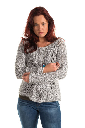 bluejeans: Pretty redheaded woman in a gray sweater and jeans Stock Photo
