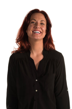 amused: Pretty redheaded woman in a purple blouse