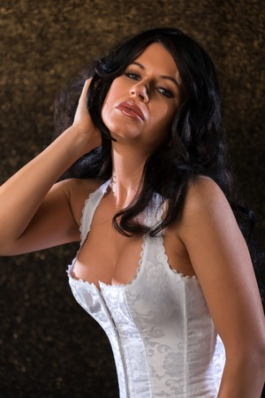 Beautiful brunette woman in a white corset