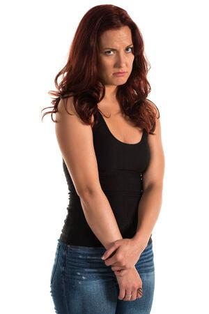 탱크 탑: Pretty redheaded woman in a black tank top 스톡 사진