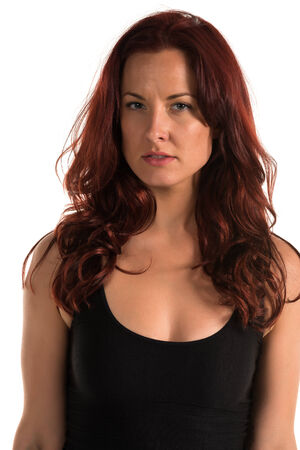Pretty redheaded woman in a black tank top Stock Photo