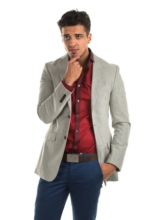 slacks: Handsome young Indian man with a thoughtful expression