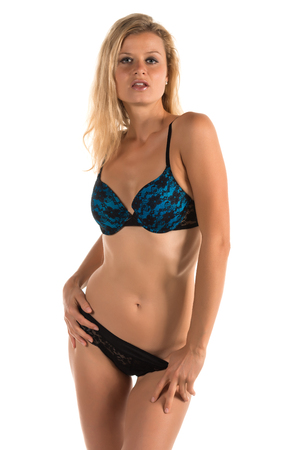 blue lingerie: Beautiful tall blonde woman in black and blue lingerie Stock Photo