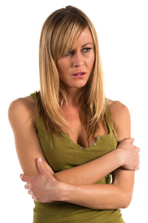Pretty petite blonde woman in an olive green tank top Stock Photo - 28530420