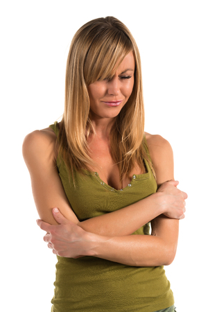olive green: Pretty petite blonde woman in an olive green tank top