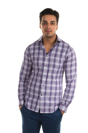 slacks: Handsome young Indian man with a cheerful expression Stock Photo