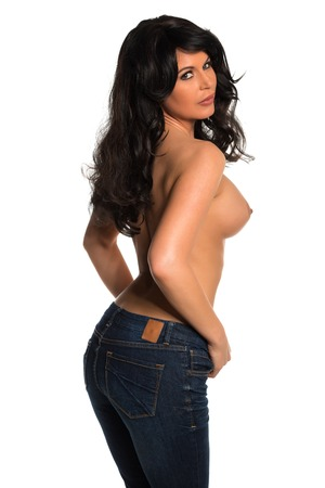 Pretty brunette woman standing topless in jeans photo