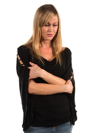 teary: Pretty petite blonde woman in black long sleeved blouse Stock Photo