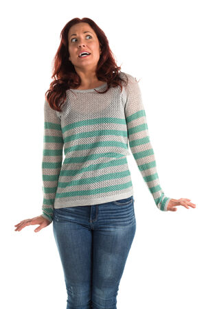 dismayed: Pretty redheaded woman in a striped sweater