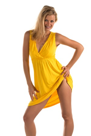 Beautiful tall blonde woman in a short yellow dress