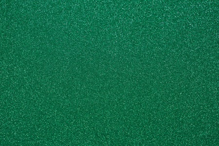 A glittering background of green and white Фото со стока