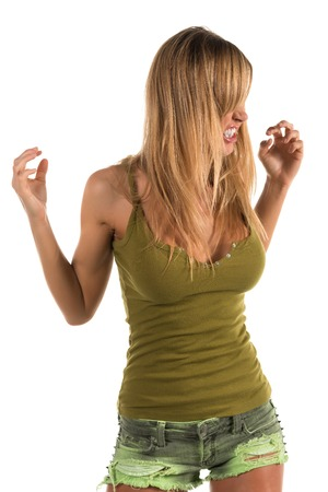 Pretty petite blonde woman in an olive green tank top photo