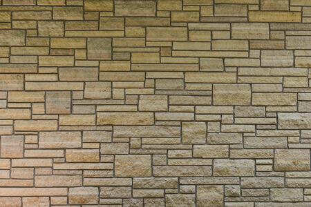 Modern stone wall of varying sizes of slabs Stock fotó