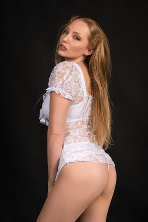 chemise: Beautiful slender blonde in a white lace chemise Stock Photo