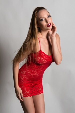 chemise: Beautiful slender blonde in a red lace chemise