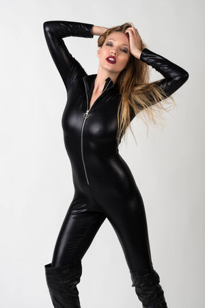 catsuit: Beautiful slender blonde in a black latex catsuit Stock Photo