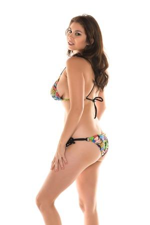 Beautiful young Eurasian woman in a skimpy bikini photo