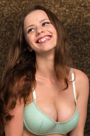 Petite young brunette in seafoam green lingerie
