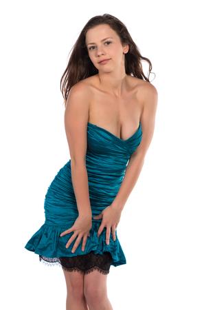 sheath: Pretty petite brunette in a turquoise sheath dress Stock Photo