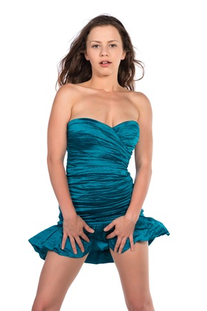 Pretty petite brunette in a turquoise sheath dress Фото со стока
