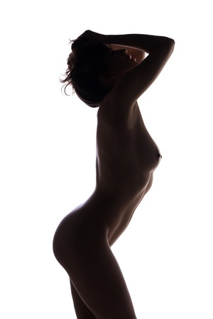 Silhouette of a young brunette nude on white Imagens