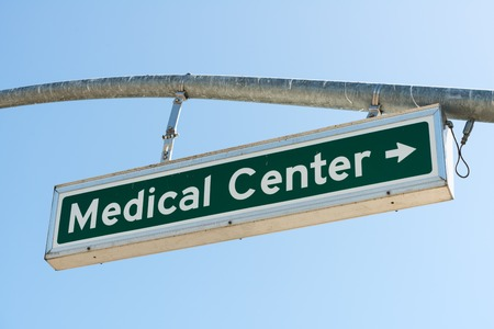 Medical Center Right Turn lighted hanging sign