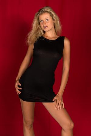 Beautiful Tall German Blonde In A Little Black Dress Stock Photo