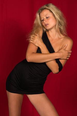 little black dress: Beautiful tall German blonde in a little black dress Stock Photo