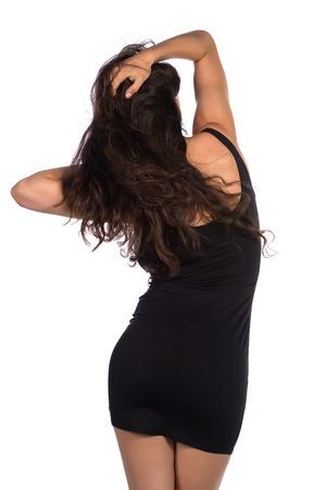 little black dress: Pretty young brunette in a little black dress Stock Photo