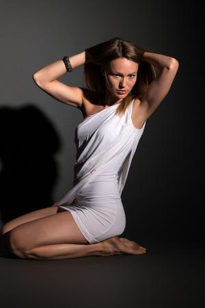 Pretty Eastern European blonde in a white wraparound dress photo