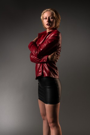 leather skirt: Beautiful young blonde in red and black