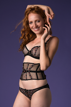 Beautiful tall redhead in sheer brown lingerie photo
