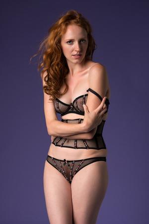 Beautiful tall redhead in sheer brown lingerie