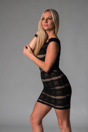 Beautiful Czech blonde in a sleeveless lace dress Banco de Imagens