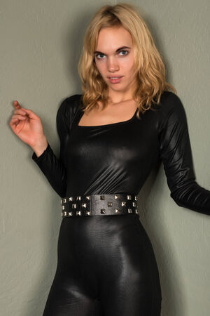 shiny black: Beautiful young blonde woman in a shiny black catsuit