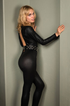 catsuit: Beautiful young blonde woman in a shiny black catsuit