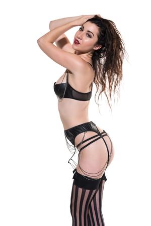 garters: Pretty petite brunette in black lingerie on white Stock Photo
