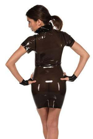 Beautiful petite Eurasian woman in a brown latex dress