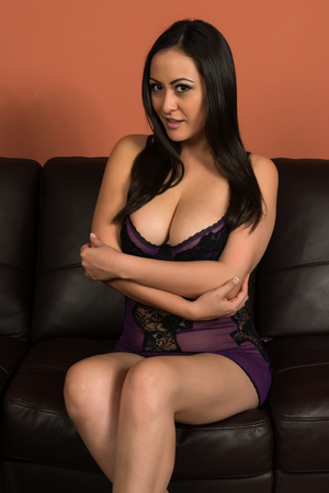 chemise: Beautiful multiracial woman in a purple camisole