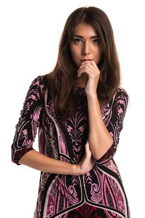 Beautiful petite Eurasian woman in a purple print dress Stock Photo