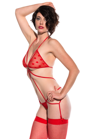 scanty clothing: Beautiful tall brunette in red lingerie on white