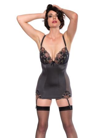 undergarment: Beautiful tall brunette dressed in gray lingerie Stock Photo